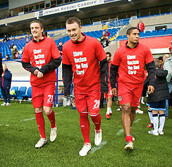 CARDIFF, WALES - Saturday, November 14, 2009: Wales' players run out wearing 'Show Racism the Red Card' shirts before the international friendly match against Scotland at the Cardiff City Stadium. Andy King, Darcy Blake and Ashley Williams. (Pic by David Rawcliffe/Propaganda)