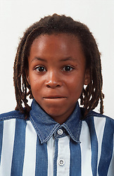 Portrait of young boy with hair in dreadlocks,
