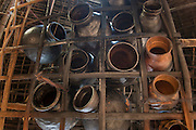 Clay pots over cooking fire<br /> Mising Tribe (Mishing or Miri Tribe)<br /> Majuli Island, Brahmaputra River<br /> Largest river island in India<br /> Assam,  ne India