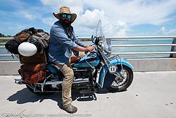 Evan Riggle riding his 1942 Indian 4-cylinder in the Cross Country Chase motorcycle endurance run from Sault Sainte Marie, MI to Key West, FL. (for vintage bikes from 1930-1948). The staging area on a Key West pier just before the finish and near the end of the 110 mile Stage-10 ride from Miami to Key West, FL USA. Sunday, September 15, 2019. Photography ©2019 Michael Lichter.