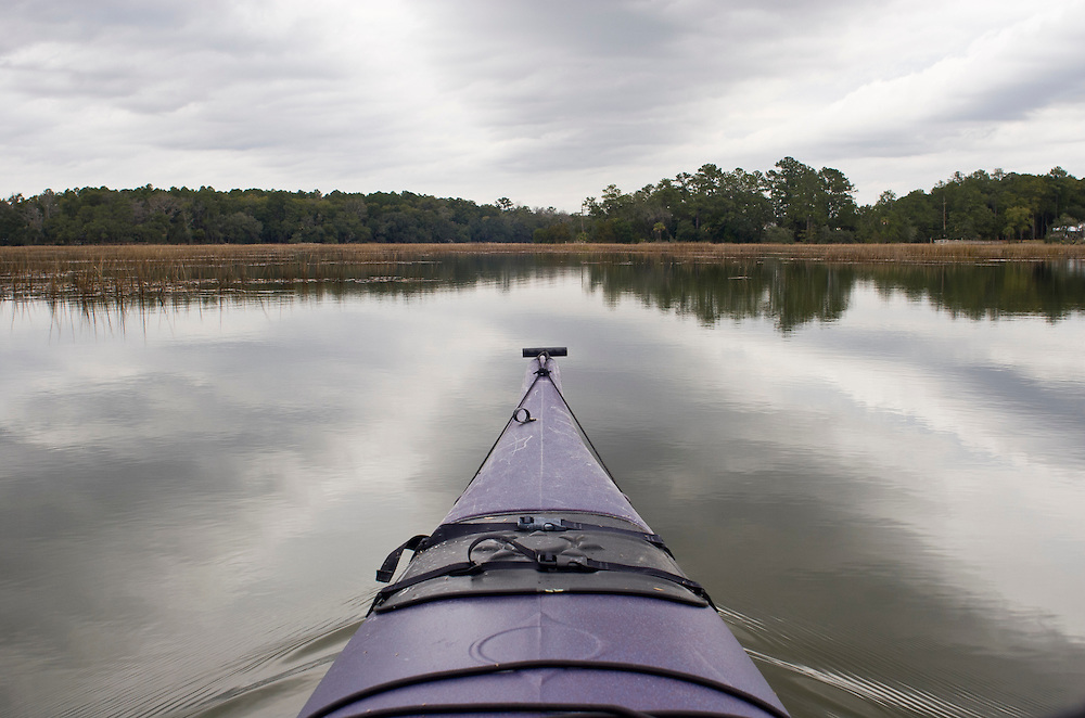 Kayak bow and Cloud Formation reflecting in the May River.