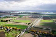 Nederland, Zuid-Holland, Hoeksche Waard, 23-10-2013; Spoorbaan HSL ter hoogte van Mookhoek met midden in beeld de tunnel onder de Dordtse Kil die boven de grond vervolgt over de Moerdijkbruggen. <br /> HST railway runs through the tunnel under the Dordrecht Kil continues across the Moerdijk bridges overground . (bottom to top) <br /> luchtfoto (toeslag op standaard tarieven);<br /> aerial photo (additional fee required);<br /> copyright foto/photo Siebe Swart.