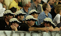 Photo: Richard Lane.<br />New Zealand v Australia. Semi-Final, at the Telstra Stadium, Sydney. RWC 2003. 15/11/2003. <br />New Zealand fans look on with disappointment.