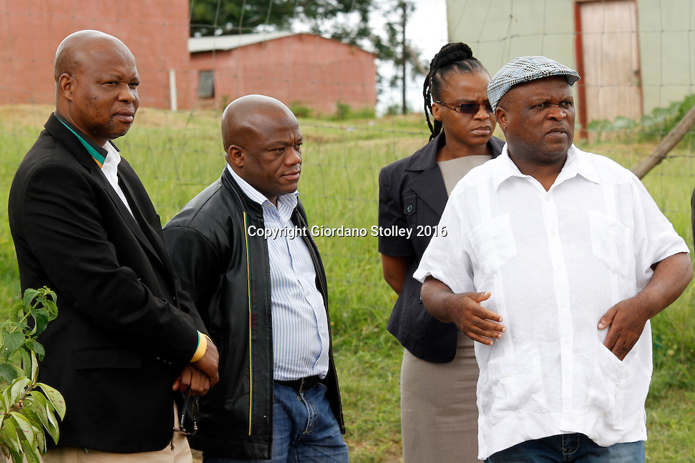 INCHANGA - 4 February 2016 - The  African National Congress's provincial secretary Super Zuma (left), the ANC's provincial chairman Sihle Zikalala, the SA Communist Party's KwaZulu-Natal treausrer Nomarashiya Caluza and the SACP's general secretary Themba Mthembu (right) wait outside the house of Philip Dlamini, and SACP member who was gunned down while attenting a politicla rally. The leadership of the two parties conducted a joint visit to the families of slain ANC and SACP members in a bid to reduce tensions between the two parties in Inchanga. Picture: Allied Picture Press/APP