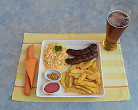 Reindeer Sausage, Chips, Cole-Slaw, and a Beer at the  Rovaniemi Train Station Dinner in Finland. Semester at Sea, Summer 2014 Voyage, Reindeer and Lappland Field Trip. Image taken with a Leica X2 camera (ISO 800, 24 mm, f/4, 1/100 sec). Raw image processed with Capture One Pro, Focus Magic, and Photoshop CC.