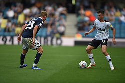 Derby County's Mason Mount takes on Millwall's George Saville