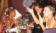 Marcus Schenkenberg & Mila Jovovich.Man Ray Restaurant Opening Party.Man Ray Restaurant.New York,  NY .July 11, 2001.Photo by Celebrityvibe.com..