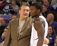 Kansas State head coach Bob Huggins (R) has a word with forward David Hoskins (R) in the first half against Cleveland State at Bramlage Coliseum in Manhattan, Kansas, December 5, 2006.  K-State beat the Vikings 93-60.<br />