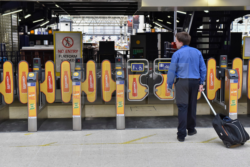 © Licensed to London News Pictures. 07/08/2017. London, UK. A commuter tries to access closed ticket gates as rail passengers face disruption at Waterloo station where nearly half the platforms have been closed until August 28 for a station upgrade.  Photo credit : Stephen Chung/LNP
