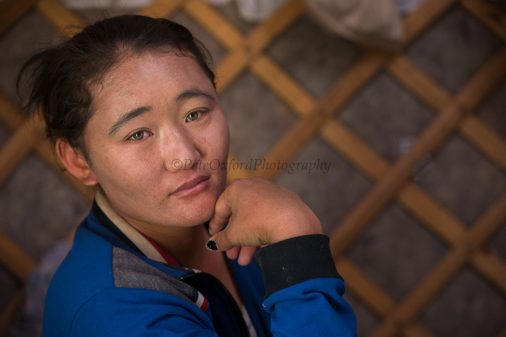 Gobi woman<br /> nomadic ger used for changing grazing seasons<br /> Gobi Desert<br /> Mongolia