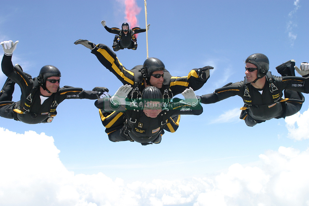 Former United States President George H.W. Bush jumps with the United States Army Golden Knights Parachute Team at the Bush Presidential Library near Houston, Texas on June 13, 2004 to celebrate his his 80th birthday. His jump was witnessed by 4,000 people including Actor and martial-arts expert Chuck Norris and Fox News Washington commentator Brit Hume. Both also participated in celebrity tandem jumps as part of the event. Bush made the jump harnessed to Staff Sergeant Bryan Schell of the Golden Knights. Bush was reportedly contemplating a free-fall jump, but officials said the wind conditions and low cloud cover made it too risky. Former Soviet President Mikhail Gorbachev was also on site. He was reportedly invited by Bush to join the jump, but said he had never parachuted and was too old to start. This was Bush's fifth jump. He also jumped with the Golden Knights on his 75th birthday. He said that he wanted to send a message to seniors that they 'still have a life.' Hand out Photo by US Army via CNP /ABACAPRESS.COM