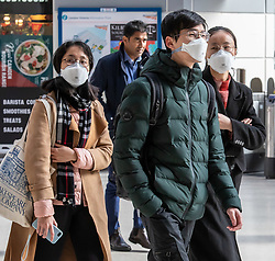 © Licensed to London News Pictures. 02/03/2020. London, UK. Passengers at Victoria Station in protective masks as fears of a pandemic increase after 4 new cases of Coronavirus are confirmed in the UK. Photo credit: Alex Lentati/LNP