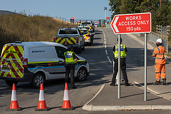 Hertfordshire Police attend a protest by environmental activists from HS2 Rebellion who used a lock-on arm tube to block a gate to the South Portal site for the HS2 high-speed rail link on 14 September 2020 in West Hyde, United Kingdom. Anti-HS2 activists simultaneously blocked two gates to the same works site for the controversial £106bn rail line, one remaining closed for over six hours and another for over nineteen hours.