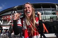 a Female Arsenal fan looking happy outside Emirates Stadium before k/o. The Emirates FA cup, 4th round match, Arsenal v Burnley at the Emirates Stadium in London on Saturday 30th January 2016.<br /> pic by John Patrick Fletcher, Andrew Orchard sports photography.