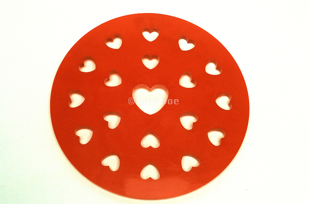 circular object with hearts cut out of it