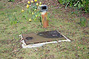 Garden septic tank access and ventilation
