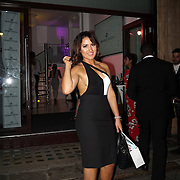 London,England,UK, 11th Aug 2016 : Taislany Gomes, fashion & beauty blogger leaving  the wine retailer hosts summer party to sample its award-winning sparkling wine range at Icetank Studios, Lo0ndon,UK. Photo by See Li