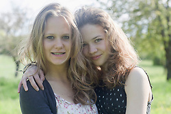 Teenage girls posing and smiling, Freiburg im Breisgau, Baden-Wuerttemberg, Germany