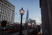 Buses and cars queue on London Bridge during the evening rush-hour, on 8th November 2018, in London, England.