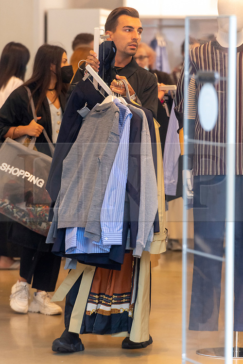 © Licensed to London News Pictures. 02/09/2021. London, UK. Customers inside the H&M Regent Street store buy items from TOGA ARCHIVES X H&M clothes collection. Designed by Yasuko Furuta, founder and designer of TOGA in collaboration with H&M, the collection. Includes women's and mens clothes. Photo credit: Ray Tang/LNP