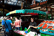 Tomato stall holder. Borough Market is a thriving Farmers market near London Bridge. Saturday is the busiest day.