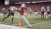 Nebraska I-back Ameer Abdullah (8) rushes into the end zone past Miami defender Artie Burns for a touchdown with 7:10 left in the second quarter of Saturday's game at Memorial Stadium in Lincoln. (Independent/Matt Dixon)