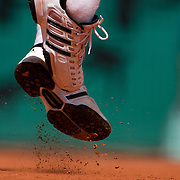 Fernando Gonzalez of Chile serving against Josselin Ouanne of France  on the Court Philippe Chatrier, the main stadium at Roland Garros during the third round match at the French Open Tennis Tournament at Roland Garros in Paris, France on Friday, May 29, 2009. Photo Tim Clayton..