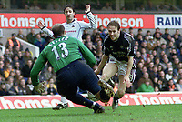 Craig Bellamy (Newcastle) is foiled by Kasey Keller (Spurs).Tottenham Hotspur v Newcastle United. 14/3/2004. Credit : Colorsport/Andrew Cowie.