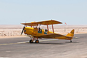 Israel, Massada Air Strip, A two seater biplane at takeoff June 27 2009.