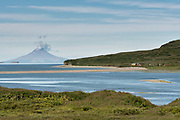 Steam releases from the dome of the St. Augustine volcano viewed from the lagoon of the McNeil River State Game Sanctuary and campsite on the Kenai Peninsula, Alaska. The remote site is accessed only with a special permit and is the world's largest seasonal population of brown bears.