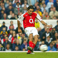 16/10/2004<br />FA Barclays Premiership - Arsenal v Aston Villa - HIghbury<br />Arsenal's Robert Pires slots home the 3rd Arsenal goal, making the score 3-1<br />Photo:Jed Leicester/BPI (back page images)