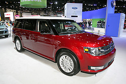 08  February 2013: 2013 Ford Flex SEL FWD 7 passenger crossover automobile. Chicago Auto Show, Chicago Automobile Trade Association (CATA), McCormick Place, Chicago Illinois<br /> <br /> 2013 FORD FLEX: Ford's distinctive Flex three-row, six/seven-passenger SUV receives a new front design for 2013 that softens the edges and adds unique Flex badging that stretches the width of the hood. All models are powered by a 3.5 liter V-6, but in two variations. Standard V-6 delivers 285 horsepower. The optional EcoBoost V-6 produces a healthy 355 hp. A six-speed automatic transmissions with fully automatic and manual control of gear selection is stock equipment with all V-6s, and buyers have the choice of front-wheel or all-wheel drive. When properly equipped, the Flex can tow up to 4,500 lbs, and with second and third row seats down, there is 83.2 cu. ft. of hauling capacity. Additional new features for 2013 include rain-sensing wipers, power-fold mirrors, redesigned interior with new instrument clusters, steering wheel, seat trim, and Flex continues to offer a refrigerated console mounted between the second-row captain's chairs. New for the Ford Flex is an Appearance Package available on Limited and SEL models that contains a two-tone black roof and black mirrors, 20-inch machined aluminum wheels with painted pockets, leather seats, unique door trim panels and other interior upgrades for a truly distinctive premium look and feel. The Flex has a nine exterior paint palette, which contains three new colors for 2013 - Ruby Red tinted clearcoat, Deep Impact Blue and Kodiak Brown. Around backside, the latest Flex models has standard dual exhaust, and an available new appliqué with integrated rear view camera.