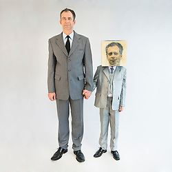 Businessman holding hands and standing near boy wearing mask