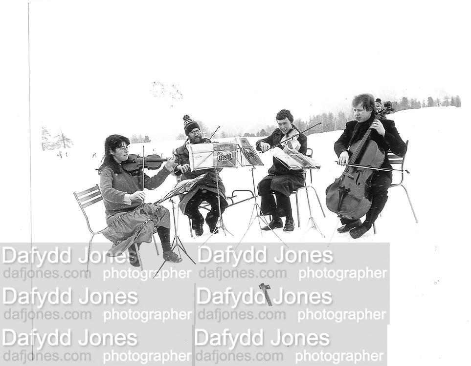 NOT the Amadeus String Quartet. Dangerous Sports Club Ski Race St. Moritz 1983© Copyright Photograph by Dafydd Jones 66 Stockwell Park Rd. London SW9 0DA Tel 020 7733 0108 www.dafjones.com