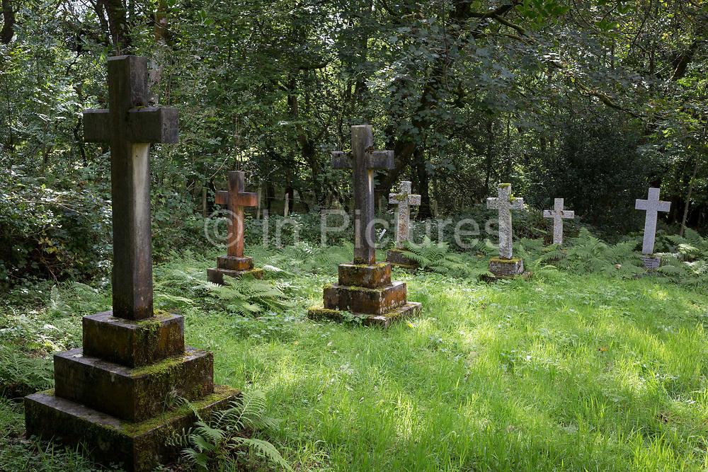 Stone crosses in the wild cemetery of St. Marks Church on 13th September 2018, in Brithdir, near Dolgellau, Gwynedd, Wales.