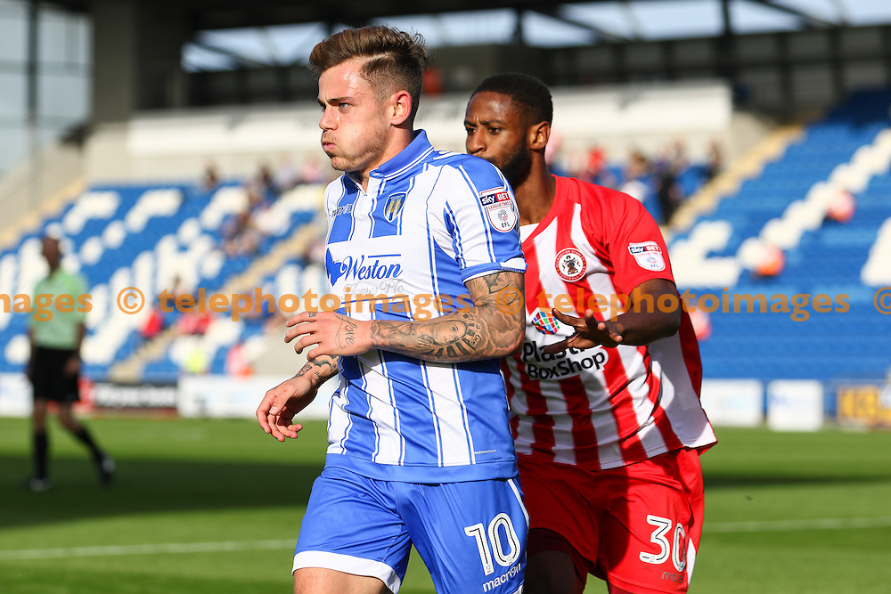 Sammie Szmodics of Colchester United (10) closely followed by Janoi Donacien of Accrington Stanley during the Sky Bet League 2 match between Colchester United and Accrington Stanley at the Weston Homes Community Stadium in Colchester. September 24, 2016.<br /> Arron Gent / Telephoto Images<br /> +44 7967 642437