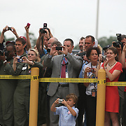 Kennedy Space Center employees and workers take photos of the Shuttle Atlantis crew after the astronauts left the operations and check-out building on their way to the pad at the Kennedy Space Center Friday, July 8, 2011, in Cape Canaveral, Fla. Shuttle Atlantis is scheduled to launch on Friday, July 8 and is the 135th and final space shuttle launch for NASA..  (AP Photo/Alex Menendez)