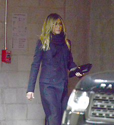"""*PREMIUM EXCLUSIVE NO WEB UNTIL 10AM PST 23RD FEB* A sad looking Jennifer Aniston makes a rare public outing after her shock separation from husband Justin Theroux. The actress looked downcast as she left the Chinese Theatre in Hollywood, where she supported her best friend Jason Bateman on his new film """"Game Night."""" Aniston, 49, and Theroux, 46, seemed very much in love during their seven years together. But reports suggest their problems centered around not being able to have children, and arguments over where they lived. He is said to have disliked Los Angeles and she couldn't stand New York City, which made her 'miserable.' Aniston had said several times in the past that she would have kids when the timing was right and she loved children, like her goddaughter Coco who is Courteney Cox's only child. And while he gave up on their marriage several months ago, the Horrible Bosses actress did not want to give up until just recently. Aniston is said to be 'sad and disappointed' after they agreed on Valentine's Day to announce they were separating. Neither one has yet to file for divorce. The Friend star is believed to have kept her $21 million L.A. mansion in her name. Theroux, who co-stars in HBO's The Leftovers, owns an apartment in New York City which he bought for $600,00 in the early 2000s and spent $1 million renovating in 2015. Aniston's total worth is estimated by Forbes at $200 million, far more than Theroux's. 21 Feb 2018 Pictured: Jennifer Aniston. Photo credit: MEGA TheMegaAgency.com +1 888 505 6342"""