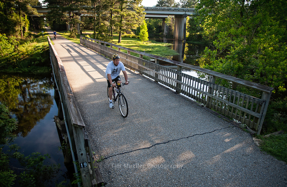 Bicyclist Stephen Creech rides the Tammany Trace Trail just south of Koop Drive in St. Tammany Parish, Louisiana.