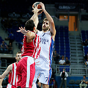 Anadolu Efes's Stratos Perperoglou (R) during their Gloria Cup Basketball Tournament match Anadolu Efes between Olympiacos at Ulker Sports Arena in istanbul Turkey on Tuesday 23 September 2014. Photo by Aykut AKICI/TURKPIX