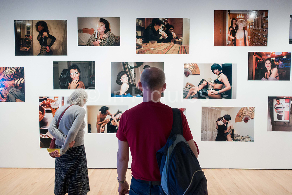 A man and an elderly woman look at photography by French artist, Kader Attia at the Hayward Gallery on the 19th April 2019 in London in the United Kingdom. In this series, Attia has taken a series of intimate photographic portraits of a group of Algerian transgender sex workers living and working in Paris. The work forms part of Attias The Museum of Emotion exhibition, a series of work from the past two decades.