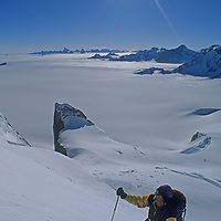 Michael Graber (MR) climbs lower slopes of The Troll's Castle in the Filchner Mountains, Queen Maud Land, Antarctica.