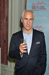 SIMON WARD at a cocktail reception to celebrate the launch of the Bicester Village the British Designer's Collective 2014 held at the The Keeper's House, Royal Academy of Art, Piccadilly, London on 20th May 2014.