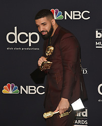 """May 1, 2019 - Las Vegas, NV, USA - LAS VEGAS, NEVADA - MAY 01: Drake poses with the awards for Top Artist, Top Male Artist, Top Billboard 200 Album for """"Scorpion"""", Top Billboard 200 Artist, Top Hot 100 Artist, Top Streaming Songs Artist, Top Song Sales Artist, Top Rap Artist, Top Rap Male Artist in the press room during the 2019 Billboard Music Awards at MGM Grand Garden Arena on May 01, 2019 in Las Vegas, Nevada. Photo: imageSPACE (Credit Image: © Imagespace via ZUMA Wire)"""