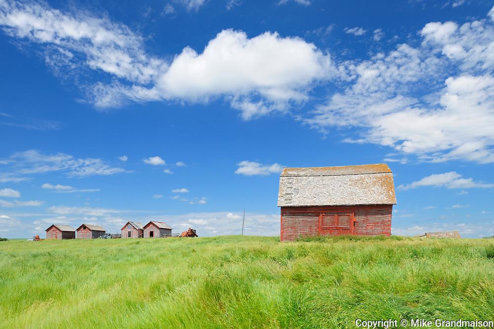 Wooden graneries and clouds<br /> Hazenmore<br /> Saskatchewan<br /> Canada