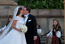 59793567 <br /> The newly wed Swedish Princess Madeleine and U.S. banker Christopher O Neill kiss outside the Royal Chapel after their wedding ceremony in Stockholm, Sweden, on June 8, 2013. UK ONLY
