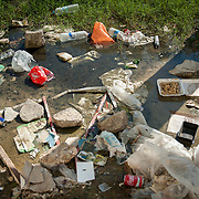 Brackish water full of rubbish in Moria camp.