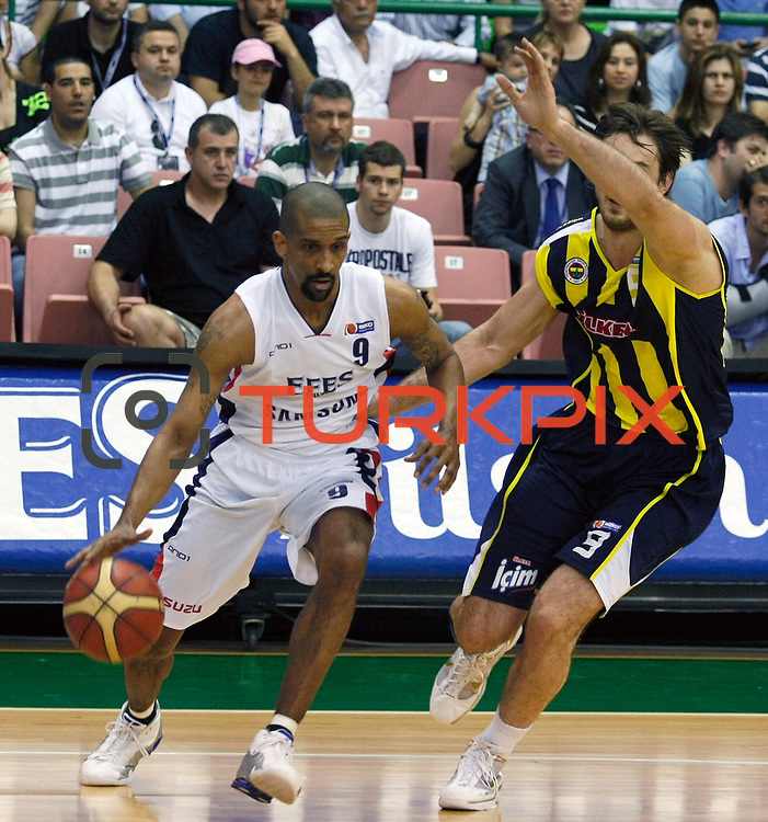 Efes Pilsen's Preston SHUMPERT (L) and Fenerbahce Ulker's Semih ERDEN (R) during their Turkish Basketball league Play Off Final fifth leg match Efes Pilsen between Fenerbahce Ulker at the Ayhan Sahenk Arena in Istanbul Turkey on Sunday 30 May 2010. Photo by Aykut AKICI/TURKPIX