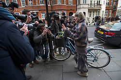 © Licensed to London News Pictures. 04/02/2016. London, UK. Dame Vivienne Westwood arrives by bicycle at the Ecuador embassy in London where WikiLeaks founder Julian Assange is currently living.  A United Nations panel is due to decide if Julian Assange has been kept in 'unlawful detention' during his stay at the embassy for the past three-and-a-half-years. Photo credit: Peter Macdiarmid/LNP