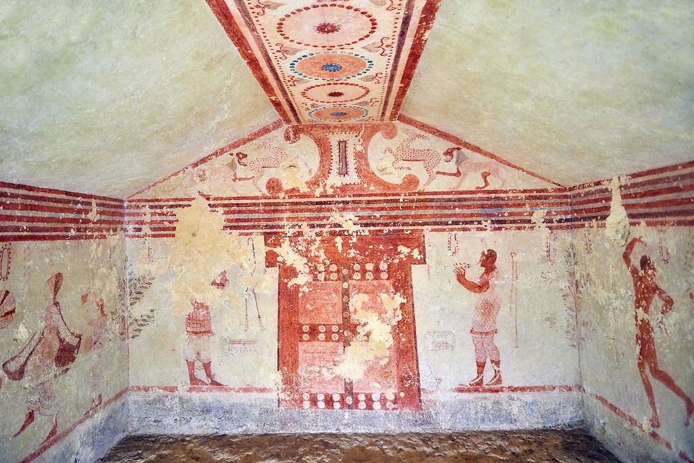 """Underground Etruscan tomb Known as """"Tomba Cardarelli"""" A single chamber with double sloping ceiling decorated with circles. In the tympanium has a scene of fighting animals below which is a flute player, a male figure holding a kylix. 510-500 BC. Excavated 1959 , Etruscan Necropolis of Monterozzi, Monte del Calvario, Tarquinia, Italy. A UNESCO World Heritage Site. .<br /> <br /> Visit our ETRUSCAN PHOTO COLLECTIONS for more photos to buy as buy as wall art prints https://funkystock.photoshelter.com/gallery-collection/Pictures-Images-of-Etruscan-Historic-Sites-Art-Artefacts-Antiquities/C0000GgxRXWVMLyc"""